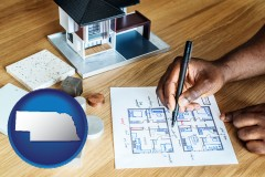 nebraska map icon and architect with model home and floor plans