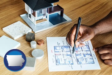 architect with model home and floor plans - with Iowa icon