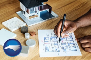 architect with model home and floor plans - with North Carolina icon