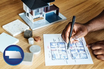 architect with model home and floor plans - with Nebraska icon